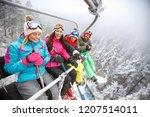 male and female skiers in ski... | Shutterstock . vector #1207514011