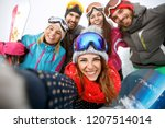 happy group of skiers together... | Shutterstock . vector #1207514014