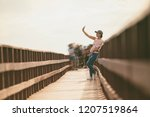 asian woman taking a selfie by... | Shutterstock . vector #1207519864