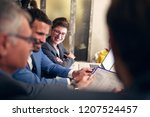 discussion of colleagues on... | Shutterstock . vector #1207524457