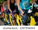 people training at a gym doing... | Shutterstock . vector #1207556044