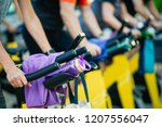 people training at a gym doing... | Shutterstock . vector #1207556047