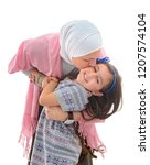 a happy muslim mother and her... | Shutterstock . vector #1207574104