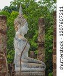 the white buddha statue in... | Shutterstock . vector #1207607311