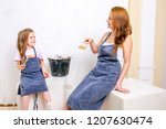 repair in the apartment. happy... | Shutterstock . vector #1207630474
