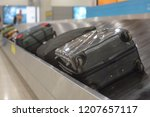 the movement of baggage on a... | Shutterstock . vector #1207657117