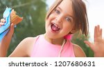 pretty little girl eating... | Shutterstock . vector #1207680631