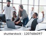 young employees sitting in the... | Shutterstock . vector #1207686097