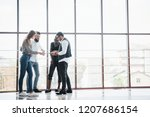 young business people are... | Shutterstock . vector #1207686154