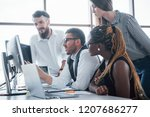 young employees sitting in the... | Shutterstock . vector #1207686277