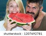happy carefree couple eat... | Shutterstock . vector #1207692781