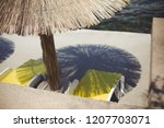 reed sunshade beside the sea | Shutterstock . vector #1207703071