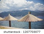 reed sunshade pattern beside... | Shutterstock . vector #1207703077