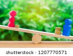 wooden figures of a man and a... | Shutterstock . vector #1207770571