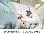 car painter with painting gun... | Shutterstock . vector #1207894951
