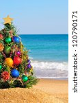 Christmas Tree On The Sand In...
