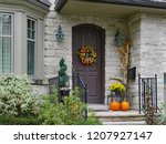 Front Door Of Stone House With...