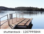 a small marina in the middle of ... | Shutterstock . vector #1207995844