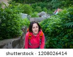 a girl with a backpack rises... | Shutterstock . vector #1208026414