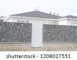 newly build gabions fence | Shutterstock . vector #1208027551