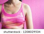 healthy woman in pink sport bra ...   Shutterstock . vector #1208029534