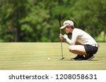 woman golfer check line for... | Shutterstock . vector #1208058631