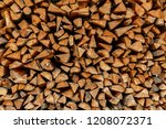 many logs are stacked and can... | Shutterstock . vector #1208072371