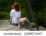 on the edge of a rocky cliff a... | Shutterstock . vector #1208072647