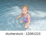 little girl in pool | Shutterstock . vector #12081223