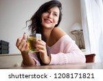 portrait of smiling woman... | Shutterstock . vector #1208171821