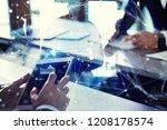 business man works in office... | Shutterstock . vector #1208178574