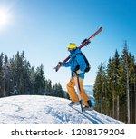 shot of a male skier walking up ... | Shutterstock . vector #1208179204