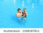 happy young couple in swimming... | Shutterstock . vector #1208187811