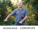 joyful senior man riding a bike ... | Shutterstock . vector #1208189194