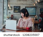 asian woman drinking coffee and ... | Shutterstock . vector #1208235007