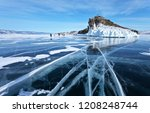 Frozen Lake Baikal. A group of tourists came on an excursion to the beautiful iced cape of Horin-Irgi or Cape Kobyliya Golova - stock photo