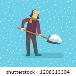 Young Man Removing Snow With A...