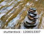 stacked flat stones on a wet... | Shutterstock . vector #1208313307