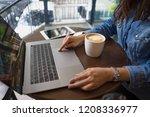 business woman hand typing... | Shutterstock . vector #1208336977