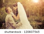 groom and bride in a park.... | Shutterstock . vector #120837565