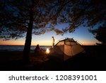 camping on sea shore at night.... | Shutterstock . vector #1208391001