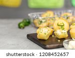 Stock photo home made cornbread muffins with spicy jalapeno pepper with butter spread 1208452657