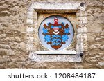 the coat of arms on the wall of ... | Shutterstock . vector #1208484187