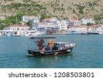 pleasure boat in the sea bay....   Shutterstock . vector #1208503801