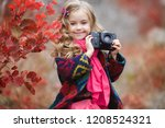 little girl child with retro... | Shutterstock . vector #1208524321