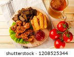 delicious fried chicken with... | Shutterstock . vector #1208525344