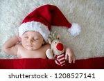 little sleeping newborn baby... | Shutterstock . vector #1208527141