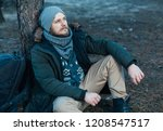 pensive hipster guy wanderlust... | Shutterstock . vector #1208547517