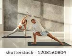 young couple practicing yoga... | Shutterstock . vector #1208560804