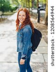 smiling friendly young redhead... | Shutterstock . vector #1208564944